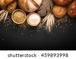 fresh bread and wheat on black... | Shutterstock . vector #459893998