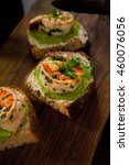 canapes with shrimps and green... | Shutterstock . vector #460076056