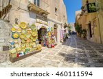 Small photo of ERICE, ITALY - SEPT 12, 2015: Sicilian souvenirs. Ancient, typical narrow and cobblestone street in Erice, Sicily, Italy