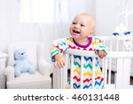 cute laughing baby standing in... | Shutterstock . vector #460131448