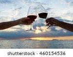 women's hands with a glass of... | Shutterstock . vector #460154536