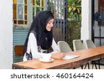 young muslim woman in head... | Shutterstock . vector #460164424