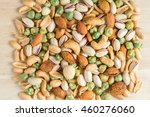 mixed nuts on wood background.... | Shutterstock . vector #460276060