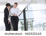 two business colleagues... | Shutterstock . vector #460320163