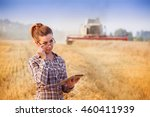 pretty farmer girl holds tablet ... | Shutterstock . vector #460411939