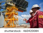 Small photo of SATTAHIP SHIPYARD, THAILAND - NOV 25 : Manager of Jack up oil and gas rig (Compact Driller, Transocean co.,Ltd) discuss with his colleague in rig maintenance operation at shipyard on Nov 25, 2013.
