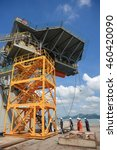 Small photo of SATTAHIP SHIPYARD, THAILAND - NOV 25 : Workers of oil and gas rig (Compact Driller, Transocean co.,Ltd) walking up stairs to work in the rig while rig maintenance operation at shipyard on Nov 25, 2013