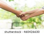 children shaking hands  | Shutterstock . vector #460426630