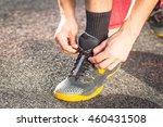 runner tying running shoes in... | Shutterstock . vector #460431508