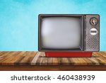 old television on wood table.... | Shutterstock . vector #460438939