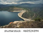 river and dam surrounded by... | Shutterstock . vector #460524394