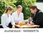 happy young businesspeople... | Shutterstock . vector #460686976