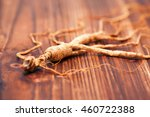 dry ginseng on a wood background | Shutterstock . vector #460722388
