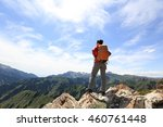 successful woman backpacker... | Shutterstock . vector #460761448