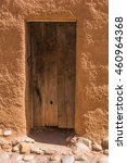 Small photo of Rustic wood door in an old adobe house in the Southwest USA