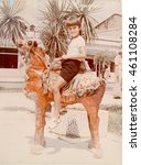 Small photo of USSR, ABKHAZIA, SUKHUMI - CIRCA 1983: Vintage photo of boy sitting on an artificial camel