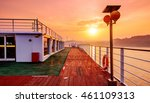 Cruise ship deck, morning sun shines on the floor, a piece of red. - stock photo