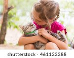 happy child with cat outdoors.  | Shutterstock . vector #461122288