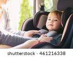 toddler girl buckled into her... | Shutterstock . vector #461216338
