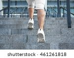 young man running on stairs | Shutterstock . vector #461261818