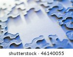 puzzle pieces with copy space and shallow depth of field in blue light - stock photo