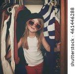 a little girl is in a closet of ... | Shutterstock . vector #461446288