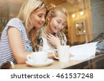 two young blond girls reading...   Shutterstock . vector #461537248