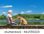 Senior Man With Old Brown Dog...