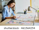 young woman sitting at the desk ... | Shutterstock . vector #461564254