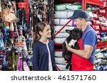 Stock photo girl looking at salesman carrying french bulldog 461571760