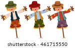 Three Scarecrows On Wooden...