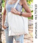 woman holding empty canvas bag...   Shutterstock . vector #461757610