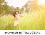 little girl running on meadow... | Shutterstock . vector #461793148