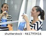 woman cleaning bathroom mirror | Shutterstock . vector #461795416