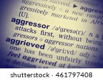 Small photo of Aggressor word in English dictionary. Clos-up shot