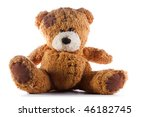 A Brown Teddy Bear With Patch...