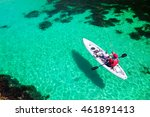 Man Fishing On A Kayak In The...