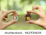 toy ceramic houses in hand   | Shutterstock . vector #461934634