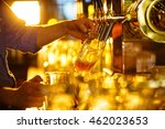Male Hands Poured Beer From The ...