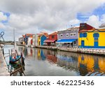 houses and boat reflected in... | Shutterstock . vector #462225436