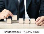 businessman holding wooden cube ... | Shutterstock . vector #462474538