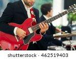 man in black suit plays red... | Shutterstock . vector #462519403