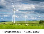 Wind Turbines In A Field With...