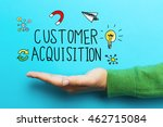 Small photo of Customer Acquisition concept with hand on vivid blue background