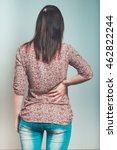 woman has back pain  isolation | Shutterstock . vector #462822244