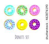 donuts colored violet green...