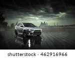 Small photo of Moscow, Russia - June 18, 2016: Gray car Mitsubishi Lancer stay and reflect in wet road in heavy rain at daytime on Moscow city