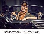 attractive brunette woman in car   Shutterstock . vector #462928534