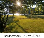 sun shines over green grass by... | Shutterstock . vector #462938140