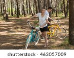 young couple with bicycle in... | Shutterstock . vector #463057009